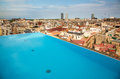 Barcelona rooftop view of rooftops and infinity pool Royalty Free Stock Photography