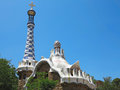 Barcelona spain the entrance of park guell with famous mosaics antonio gaudi over blue sky background Stock Photo