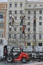 Workers build a metal structure for the stage in the town square in Barcelona Royalty Free Stock Photo