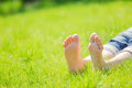 Bare feet on green grass with autumn leaves Royalty Free Stock Photo
