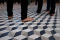 Bare feet of pilgrims on tile floor a closeup the as they dance in a circle an old tiled temple Stock Photos