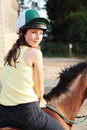 Bareback riding a girl a horse Stock Image