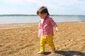 Barefoot baby boy walking on riverside lovely Stock Photo