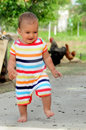 Barefoot baby happy child running in the yard Royalty Free Stock Image