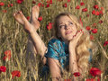 Barefoot blonde in poppies Stock Photography
