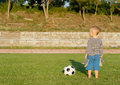 Barefoot boy with soccer ball Royalty Free Stock Photo