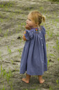 Barefoot child on field Royalty Free Stock Photography