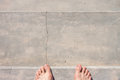 Barefoot on concrete surface Royalty Free Stock Photo