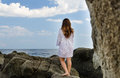 Barefoot woman enjoying the solitude of the coast Stock Photo