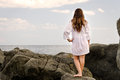 Barefoot woman enjoying the solitude of the coast Royalty Free Stock Photos