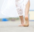 Barefoot woman walking away Royalty Free Stock Photo