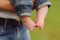 Barefooted boy in jeans father s arms Stock Photography