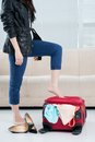 Barefooted woman standing her suitcase Stock Photography