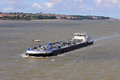 Barge moving in the waterways of Liverpool Royalty Free Stock Photo