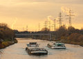 Barges plying waterway channel in industrial area Royalty Free Stock Photo