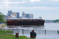 Barges and skyscrapers of saint paul minnesota lined up on flooded banks mississippi river in downtown Stock Photos