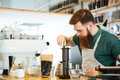 Barista making coffee Royalty Free Stock Photo