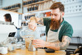 Barista pouring water in glass Royalty Free Stock Photo