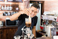 Barista preparing drip coffee in asian coffee shop using professional machine parts Royalty Free Stock Images