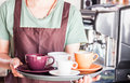 Barista preparing set of freshly brewed coffee for serving stock photo Royalty Free Stock Image