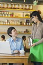 Barista serving coffee to customer, Beijing Royalty Free Stock Photo