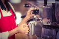 Barista steaming milk at the coffee machine Royalty Free Stock Photo