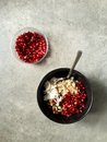 Barley porridge with coconut pistachios pomegranate seeds pomegranate molasses top down shot of breakfast a black bowl filled Royalty Free Stock Photos