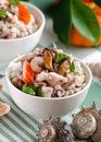 Barley salad with seafood in white bowl Stock Images