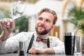 Barman checking the cleanliness of glass elegant at restaurant Royalty Free Stock Photo