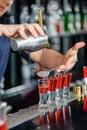 Barman makes shots in a bar Royalty Free Stock Photo
