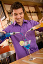 Barman making cocktail male a at the bar Royalty Free Stock Photo