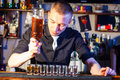 Barman making  drink shots Royalty Free Stock Photo