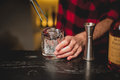Barman pouring ice in glass.Bartender preparing cocktail drink. Royalty Free Stock Photo