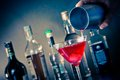 Barman pouring a red cocktail into a glass with ice Royalty Free Stock Photo