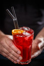 Barman serve red cocktail Royalty Free Stock Photo