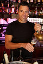 Barman Standing Behind Bar Pouring Beer Royalty Free Stock Photos