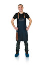 Barmen a shoot of young caucasian man in apron as a with arms akimbo isolated against white background Royalty Free Stock Photos