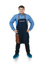Barmen a shoot of young caucasian man in apron as a with arms akimbo isolated against white background Stock Photo