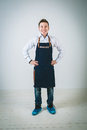 Barmen a shoot of young caucasian man in apron as a with arms akimbo isolated against white background Royalty Free Stock Photography
