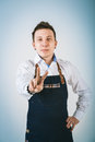 Barmen a shoot of young caucasian man in apron as a isolated against white background Royalty Free Stock Photo