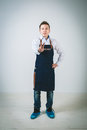 Barmen a shoot of young caucasian man in apron as a isolated against white background Royalty Free Stock Image