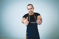 Barmen a shoot of young caucasian man in apron as a showing the sign good thumbs up Royalty Free Stock Image