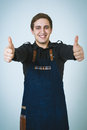 Barmen a shoot of young caucasian man in apron as a showing the sign good thumbs up Royalty Free Stock Photo