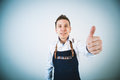 Barmen a shoot of young caucasian man in apron as a showing the sign good thumbs up Stock Photography