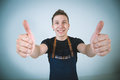 Barmen a shoot of young caucasian man in apron as a showing the sign good thumbs up Royalty Free Stock Photos