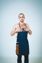 Barmen a shoot of young caucasian naked man in apron as a isolated against white background Royalty Free Stock Photo