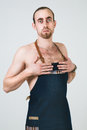 Barmen a shoot of young caucasian naked man in apron as a isolated against white background Royalty Free Stock Photos