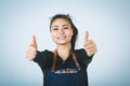 Barmen a shoot of young caucasian woman in apron as a showing the sign good thumbs up Stock Photography