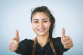 Barmen a shoot of young caucasian woman in apron as a showing the sign good thumbs up Royalty Free Stock Photos