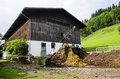 Barn in austrian farm front of mountains Royalty Free Stock Image